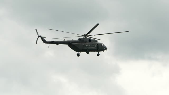 helicopter passing the sky - helicopter stock videos and b-roll footage