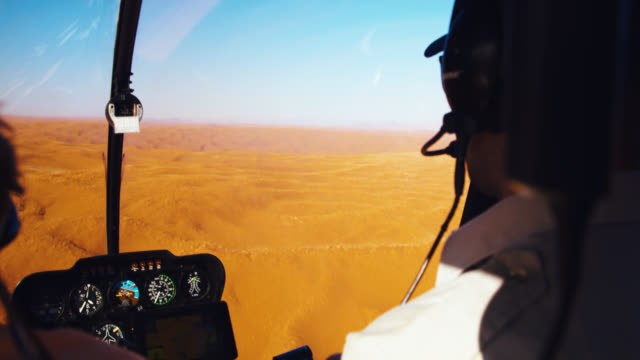 cu helicopter pilot and passenger flying over deadvlei sand dunes,namibia,africa - bare tree stock videos & royalty-free footage