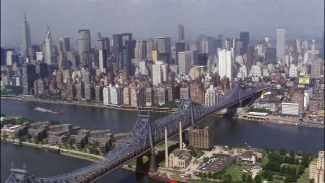 a helicopter pilot flies across the east river toward the skyscrapers of manhattan. - 1970 stock videos & royalty-free footage