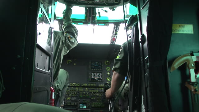 hd: helicopter pilots - military helicopter stock videos & royalty-free footage