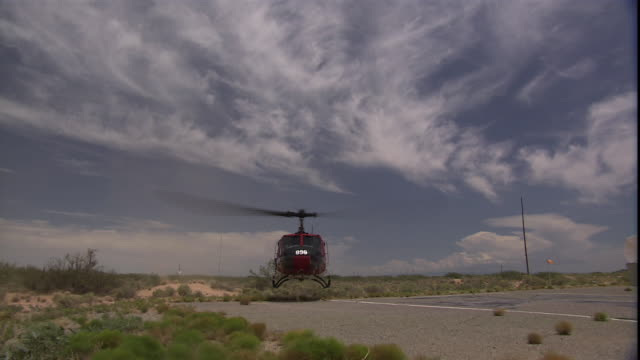 a helicopter prepares for take off. - white sands missile range stock videos & royalty-free footage