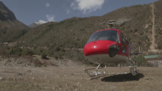 helicopter prepares to launch from gravel pad - helicopter stock videos & royalty-free footage