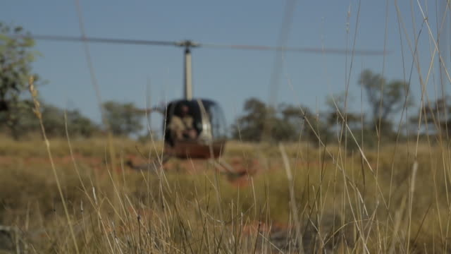 helicopter ready for takeoff, outback australia - airfield stock videos & royalty-free footage