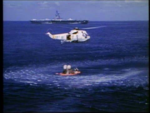 aerial helicopter rescues astronauts from capsule in ocean / apollo 17 - splashdown stock videos and b-roll footage