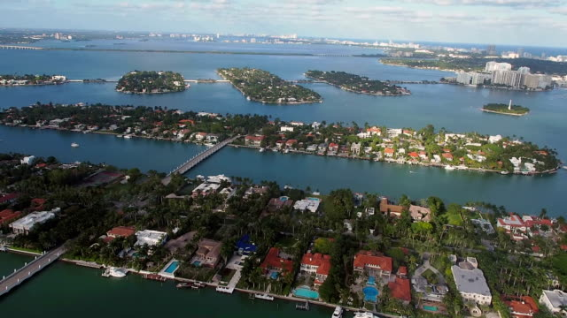 helicopter ride over hibiscus and palm island - biscayne bay stock videos and b-roll footage