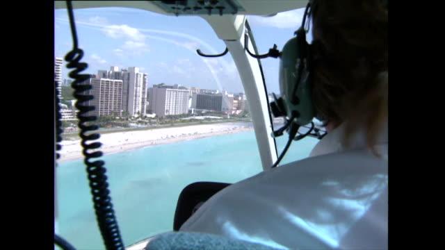 helicopter pov shot along coastline of miami beach; 1992 - headphones stock videos & royalty-free footage