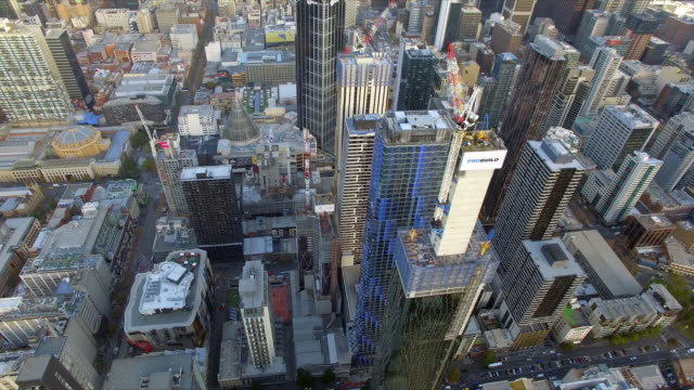 stockvideo's en b-roll-footage met a helicopter shot flying over new apartment development in melbourne's central business district. - david ewing