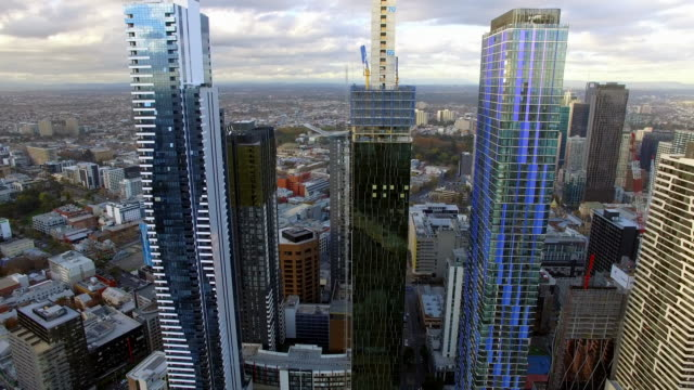 a helicopter shot flying over new apartment development in melbourne's central business district. - david ewing stock videos & royalty-free footage