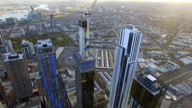 a helicopter shot flying over new apartment development in melbourne's central business district. - david ewing stock-videos und b-roll-filmmaterial