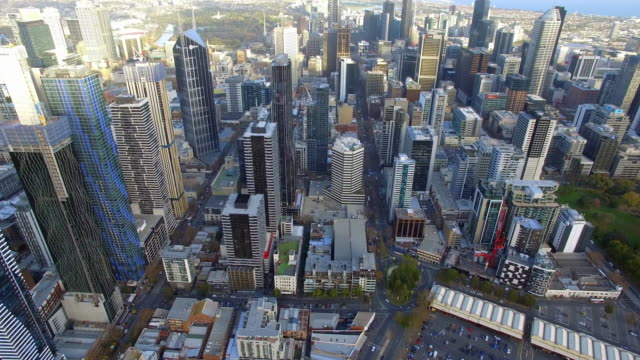 a helicopter shot flying over new apartment development in melbourne's central business district. - financial district stock videos & royalty-free footage