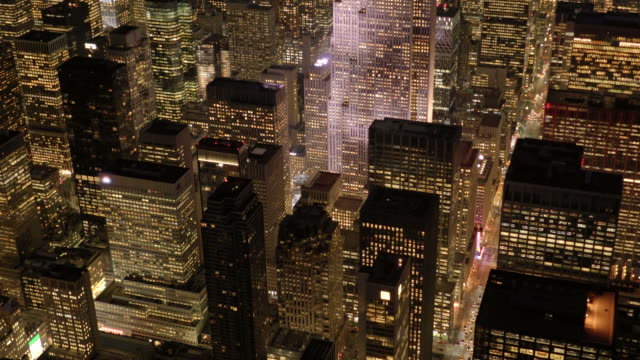 helicopter shot of cityscape metropolis skyline. aerial view of new york city at night