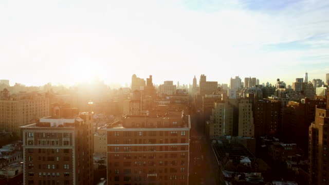 helicopter shot of new york city skyline landmark at sunrise - busy morning stock videos & royalty-free footage