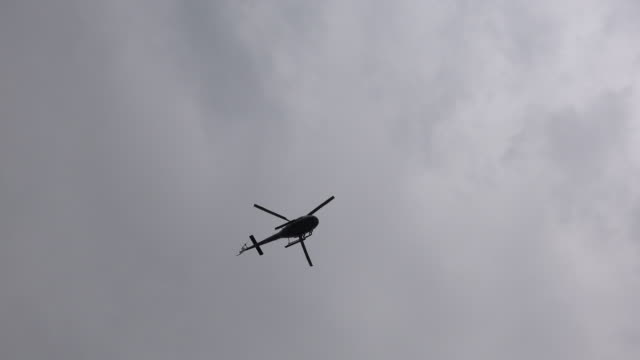 helicopter silhouette - directly below stock videos & royalty-free footage