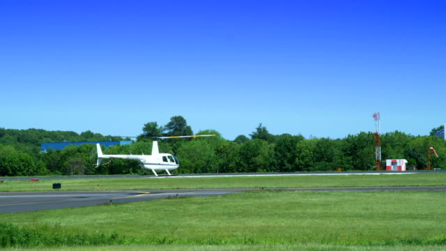 hd: helicopter takeoff on runway - helicopter landing stock videos & royalty-free footage