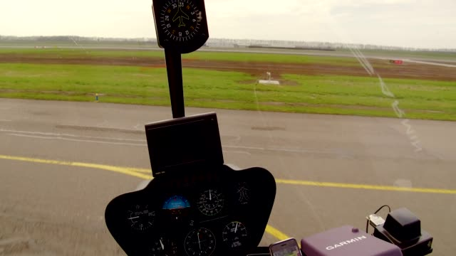 helicopter takeoff, view from inside the cockpit looking out - innerhalb stock-videos und b-roll-filmmaterial