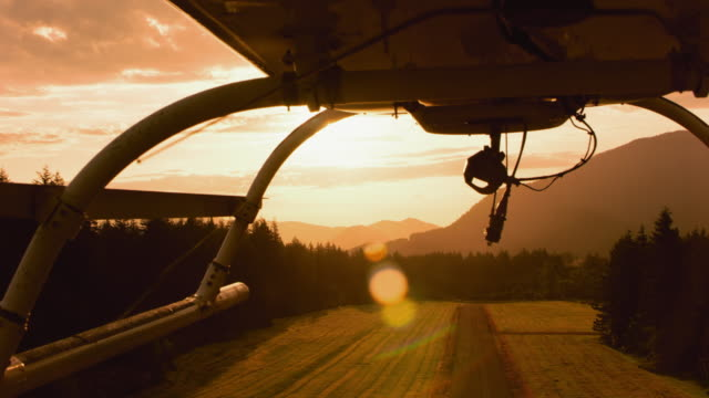 aerial helicopter taking off at sunrise - helicopter stock videos and b-roll footage
