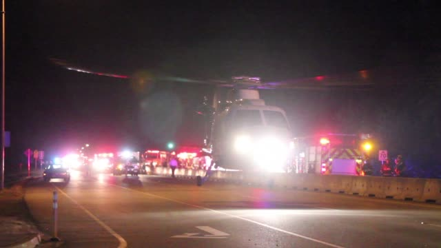 MEDEVAC helicopter taking off from crash scene