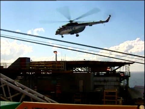 helicopter taking off from oil rig platform russia - helicopter landing pads stock videos and b-roll footage