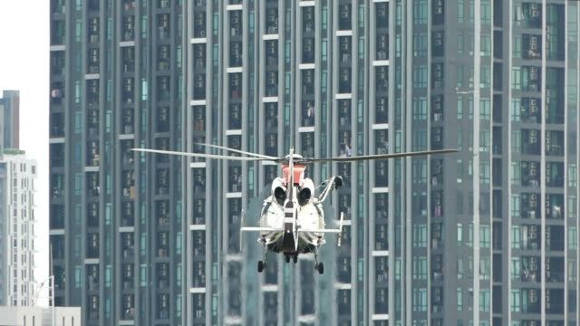 helicopter taking off in front of buildings - helicopter stock videos and b-roll footage