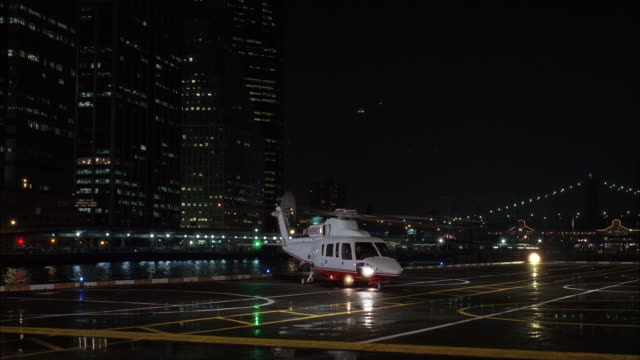 ms helicopter taking off in new york city and flying toward couple of office buildings / new york, new york, united states  - helicopter stock videos & royalty-free footage