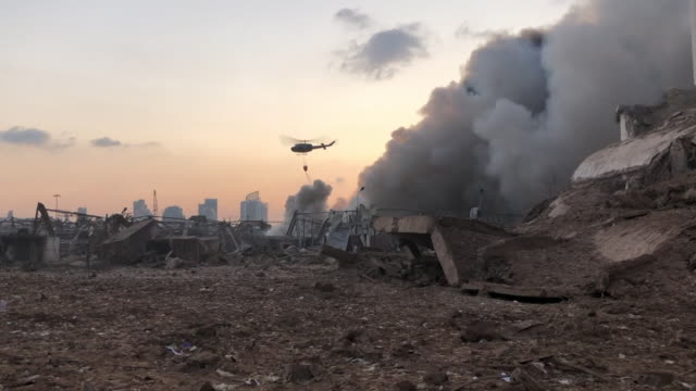 helicopter tipping water over fires at beirut port after massive explosion there, caused by the unsafe storage of ammonium nitrate, lebanon - bombing stock videos & royalty-free footage