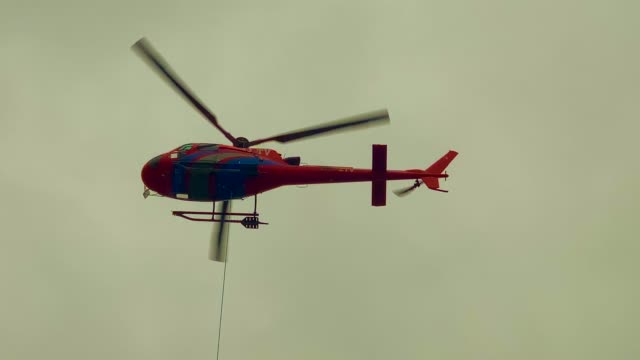 helicopter transport construction material - helicopter stock videos & royalty-free footage