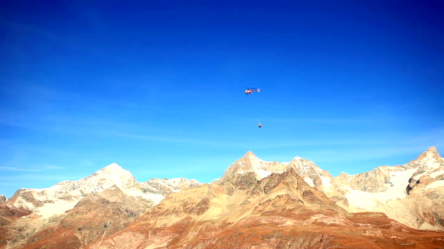 helicopter transporting materials over matterhorn - pennines stock videos & royalty-free footage