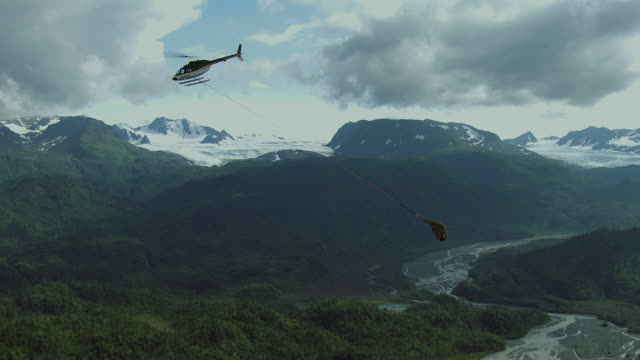helicopter transports cargo in alaska - kenai stock videos & royalty-free footage