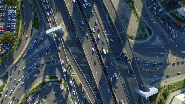 a helicopter view of melbourne's west gate freeway. - traffic stock videos & royalty-free footage