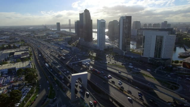 a helicopter view of melbourne's west gate freeway. - david ewing stock-videos und b-roll-filmmaterial