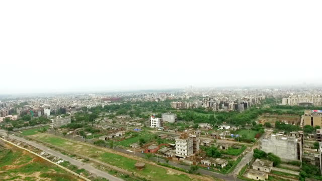 helicopter view of the city - delhi stock videos & royalty-free footage