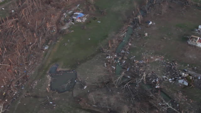 helicopter view of tornado aftermath - houses and forest destroyed - damaged stock videos & royalty-free footage