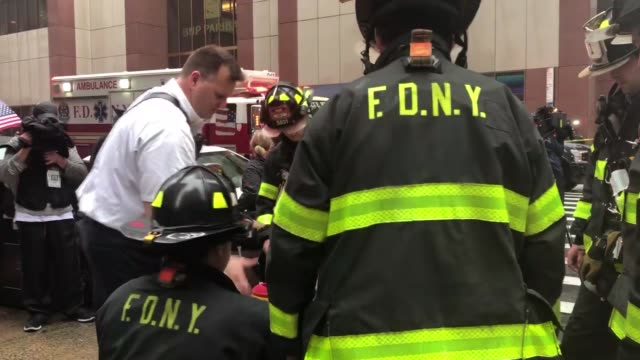 a helicopter was forced into an emergency landing monday and crashed on top of a 54story building in manhattan according to new york city officials... - fire department of the city of new york stock-videos und b-roll-filmmaterial