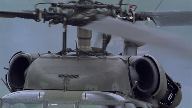 cu, helicopter with soldiers flying off, usa - helicopter rotors stock videos and b-roll footage