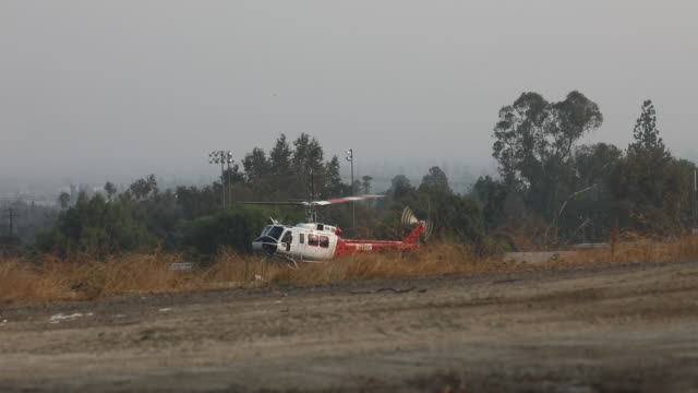 helicopter with water container landing bobcat fire in angeles national forest the us west is bracing for another blast of dry and windy weather... - sierra madre stock videos & royalty-free footage