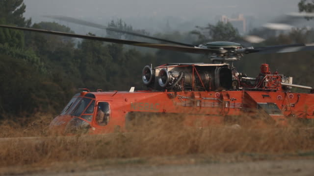 helicopter with water needed to extinguish fire taking off bobcat fire in angeles national forest the us west is bracing for another blast of dry and... - sierra madre stock videos & royalty-free footage