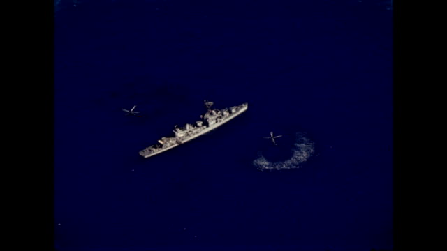 helicopters and naval ship assist with recovery of mercury freedom 7 capsule on may 05 1961 - 1961 stock videos & royalty-free footage