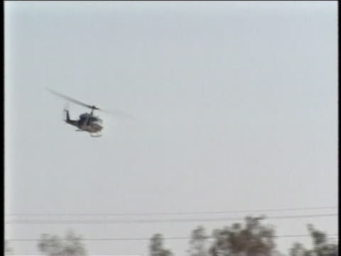 helicopters approach and bank to the left. - al fallujah stock videos & royalty-free footage