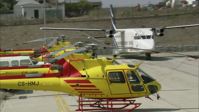 aerial ws helicopters at cascais airport / cascais, lisbon, portugal - cascais stock videos and b-roll footage