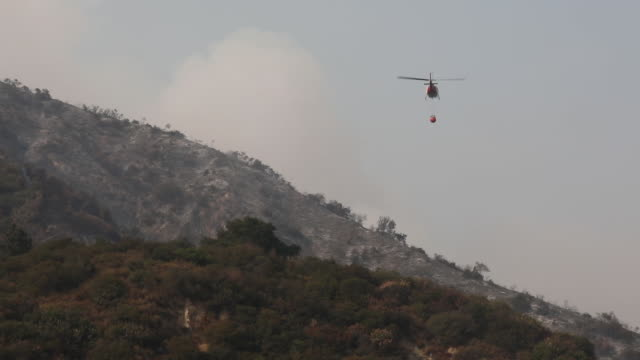 helicopters during extinguishing wildfires action in california bobcat fire in angeles national forest the us west is bracing for another blast of... - sierra madre stock videos & royalty-free footage