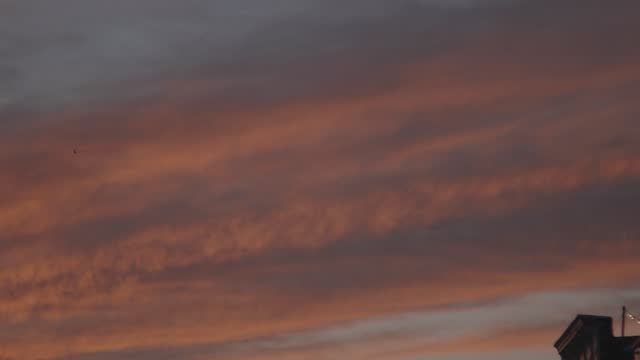 helicopters fly over a pink sunset in canton on february 5, 2021 in baltimore, maryland. there have been 7,329 coronavirus deaths in maryland. - pink colour stock videos & royalty-free footage