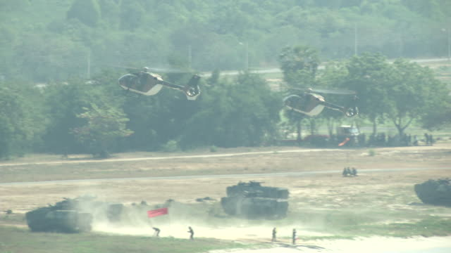 Helicopters land with an amphibious assault vehicles and secure the beach head during the ongoing USThai joint military exercise titled Cobra Gold on...
