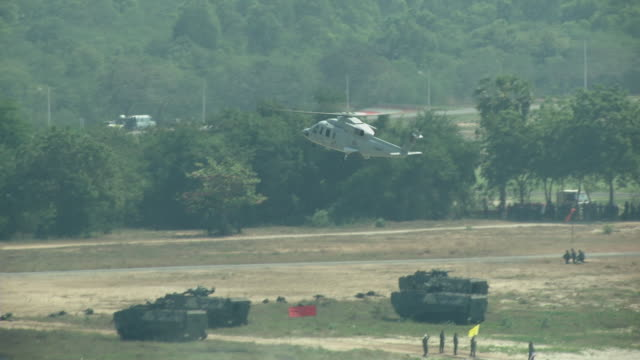 helicopters land with an amphibious assault vehicles and secure the beach head during the ongoing usthai joint military exercise titled cobra gold on... - military exercise stock videos and b-roll footage