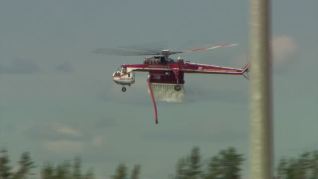 Helicopters pouring water on to wildfires in Fort McMurray Canada