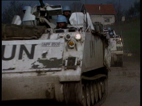 stockvideo's en b-roll-footage met un helicopters succeed in bringing out wounded people from besieged town of srebrenica / un helicopters landing and taxiing / ambulances parked on... - 1993