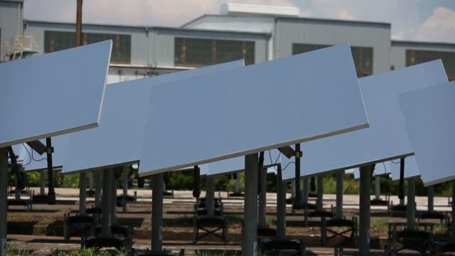 heliostats collect sunlight at mitsubishi hitachi power systems ltd's solar thermal power system verification testing facility at the mhps yokohama... - verification stock videos & royalty-free footage