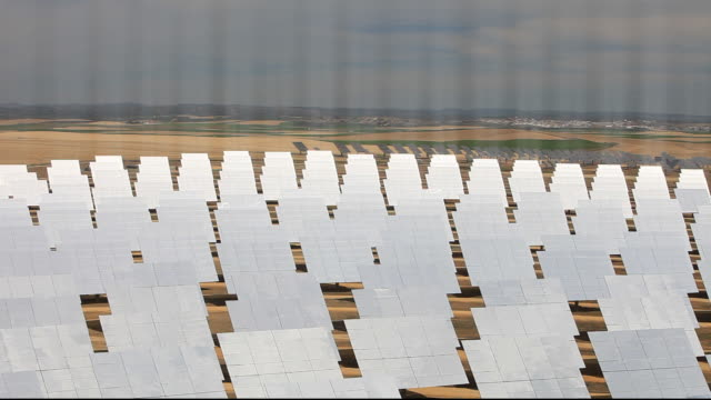 Heliostats, large mirrors reflecting the suns energy onto the PS20 solar thermal tower. Its is part of the Solucar solar complex owned by Abengoa energy, in Sanlucar La Mayor, Andalucia, Spain. The site has solar tower, parabolic trough and photovoltaic so