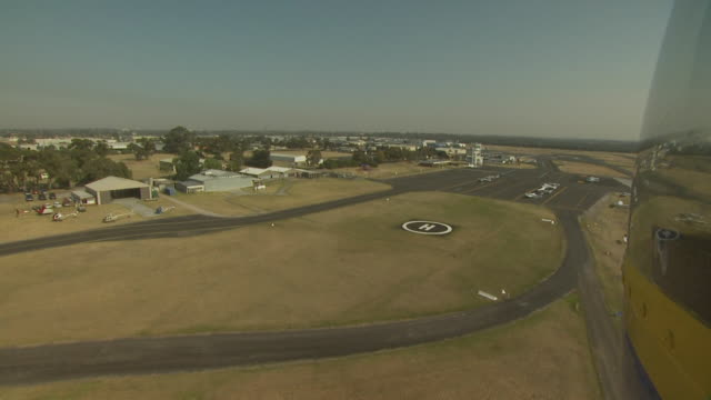 helipad approach from helicopter in flight, australia - helicopter landing pads stock videos and b-roll footage