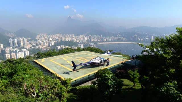 helipad on top of sugarloaf mountain in brazil on june 7th 2013 - helipad stock videos & royalty-free footage