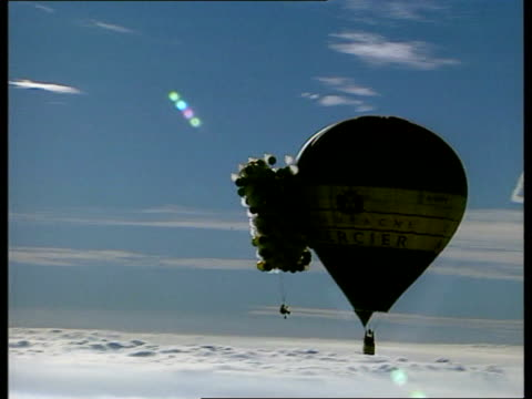 helium balloon flight; england: gloucs: ross on wye: helium filled balloon with logo mercier champagne pull out to show woman towards to attach... - roped off stock videos & royalty-free footage